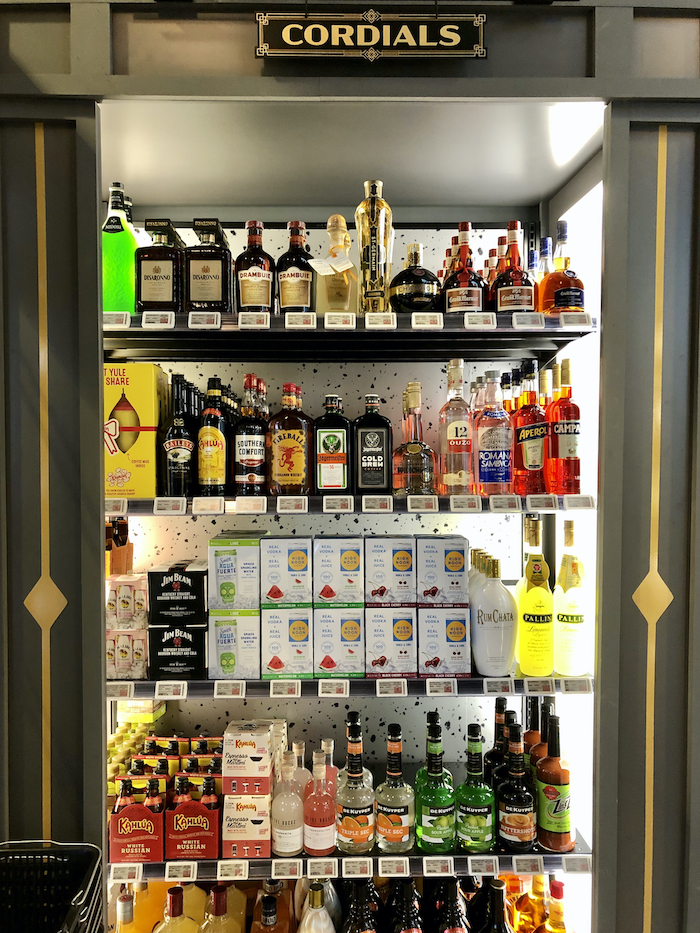 Cordials shelf at Knock Knock, featuring mixers and hard seltzers