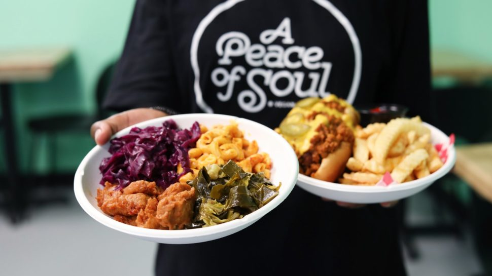 Peace of Soul employee holding two plates of food