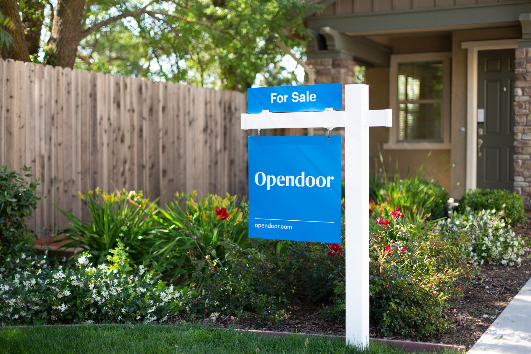 For sale sign in front of a home